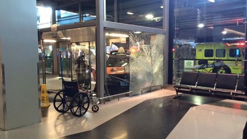 Cab plows into door at Chicago airport
